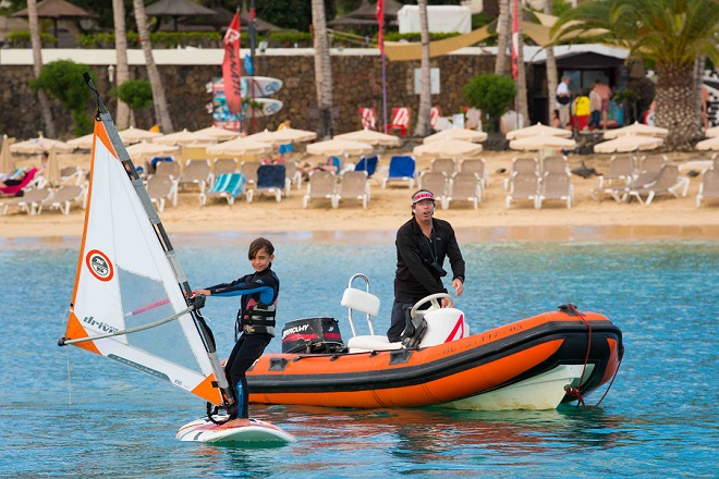 Beginners learning windsurfing in the bay of Las Cucharas